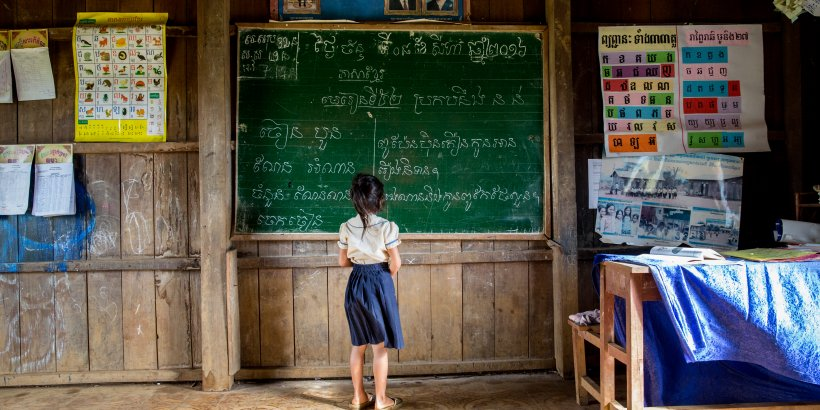 A girl is in front of a board