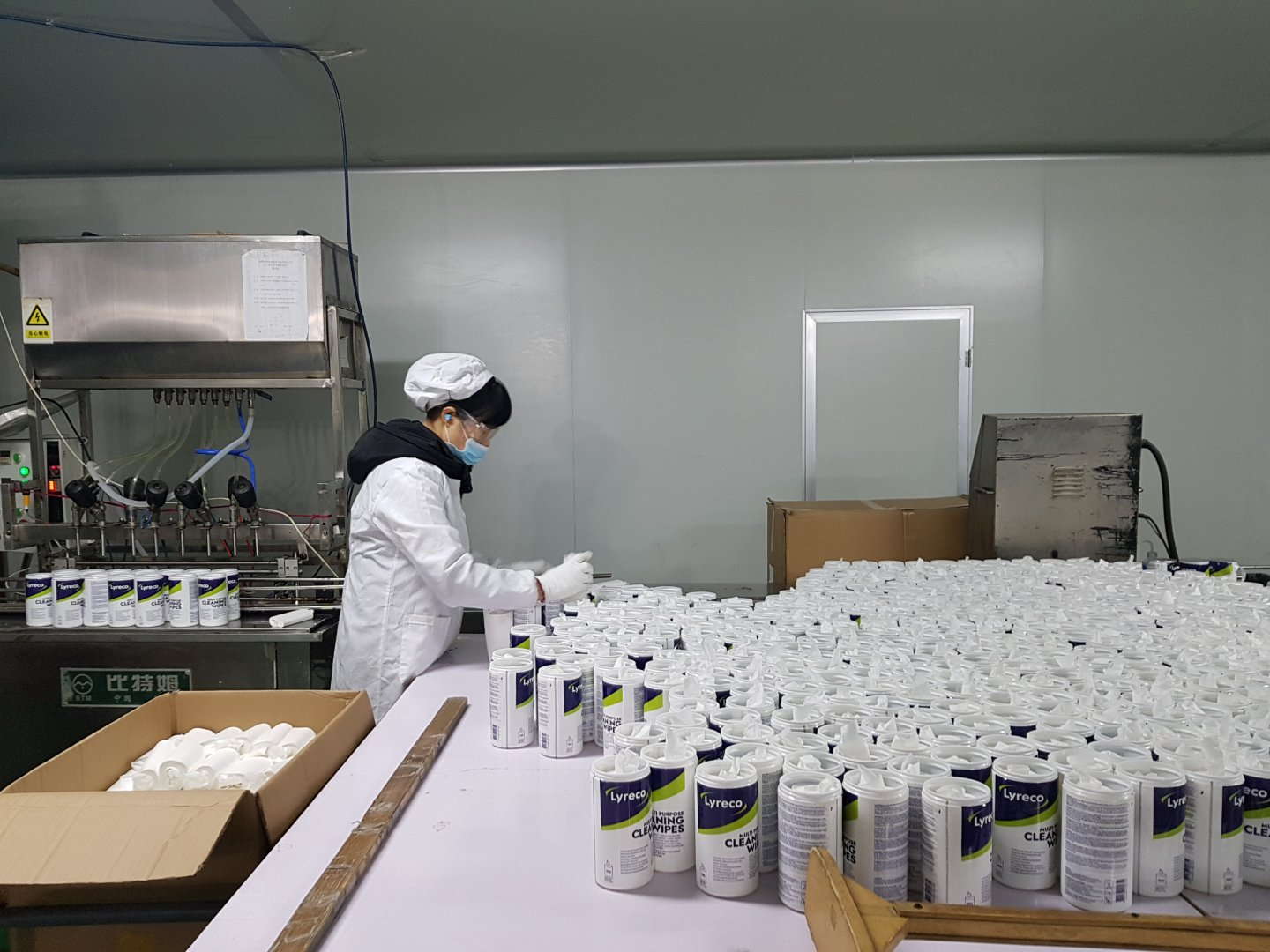A worker is sorting Lyreco products